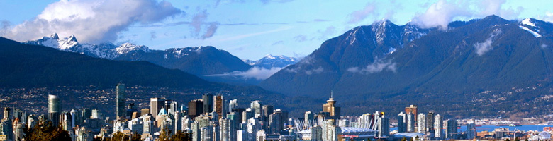 Site header image of the city of Vancouver and the mountains in the background